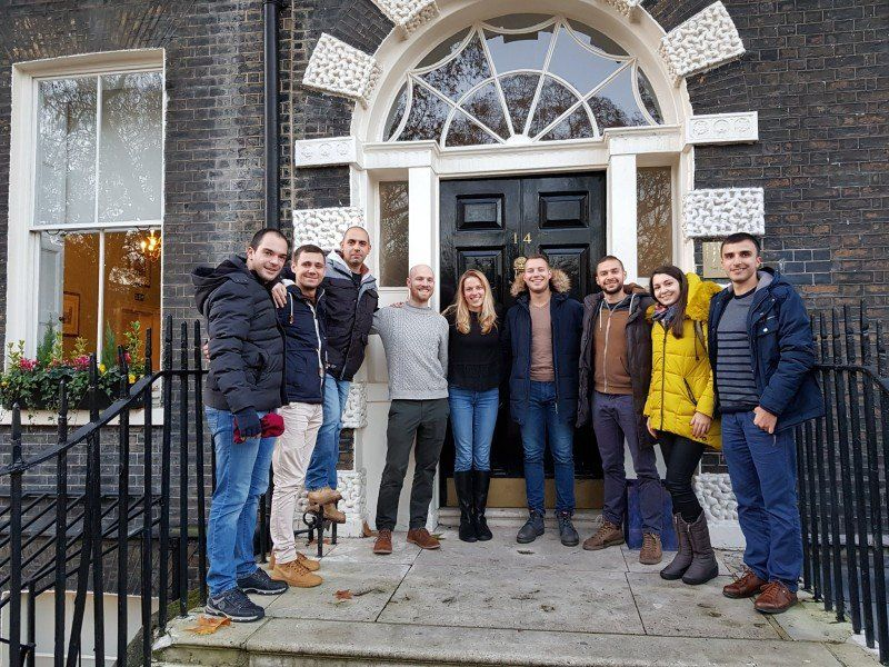 The team in front of The Collective office in London, UK